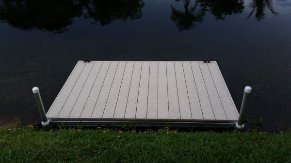 Floating dock with spud pole bracket